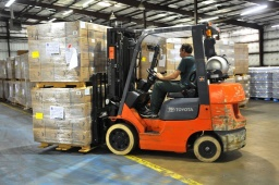Man-driving-a-forklift-in-a-warehouse.jpg